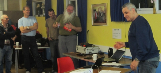 Clive G1EUC, lobbing the Easter Egg quiz prize to Peter G0DZB
