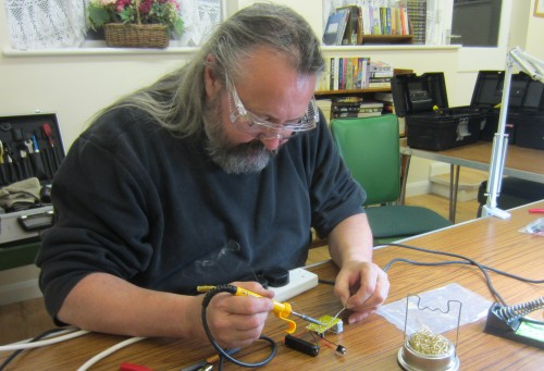 Chris G0IPU getting stuck into the soldering demo