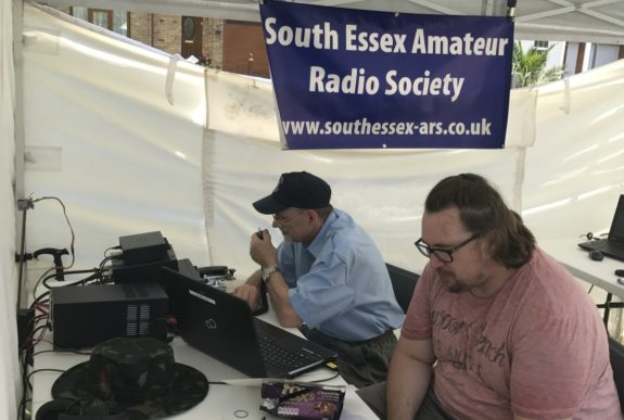 Dave G4AJY operating HF voice (rare sight!) with Henry watching