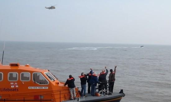 Radio Caroline Team waving to the RAF Seaking Helicopter
