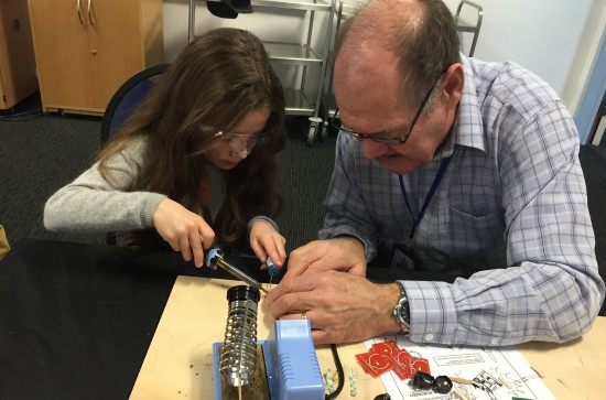 Essex Ham's youngest member learning how to solder with SOSLUG