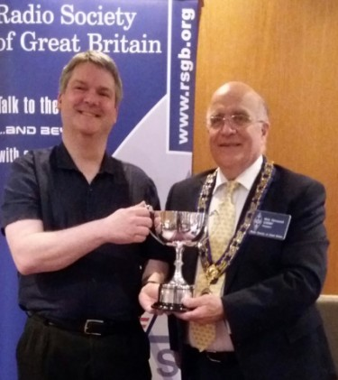 Pete M0PSX receiving the Kenwood Trophy for Essex Ham from RSGB President Nick Henwood