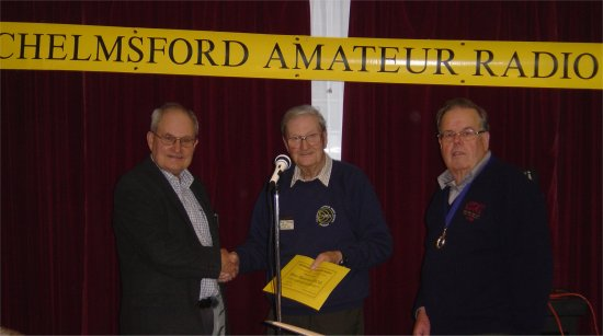 Brian G3CVI receiving his certificate for gaining first place in CARS January 80M Fun Contest (Courtesy Colin G0TRM)