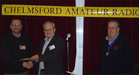 Patrick M0XAP receiving his certificate for gaining second place in CARS January 80M Fun Contest (Courtesy Colin G0TRM)