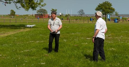 Pete M0PSX demoing  the Essex Ham quadcopter to Trevor M5AKA