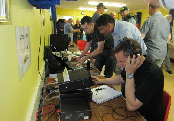 Charlie M0PZT  helping Peeyush M0JAI, with Rob M0KCP operating 20m CW