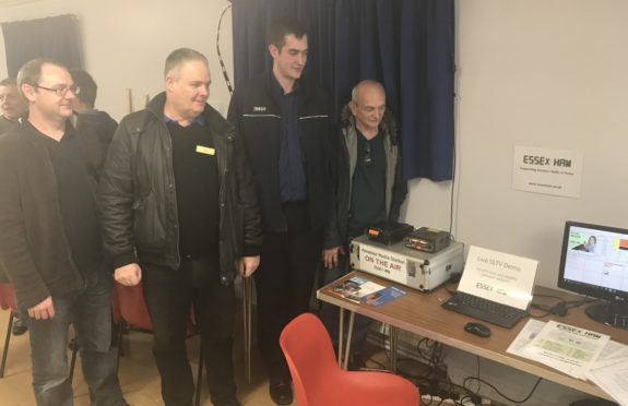 Badly-posed & lit pic of 4 chaps watching SSTV