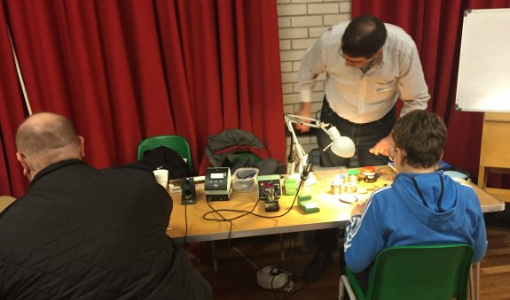 Dave G4HUP helping with soldering at Suffolk RED - Dec 2015